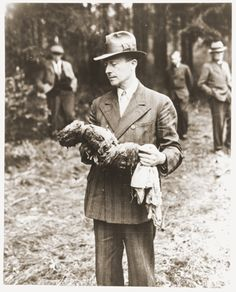 File:German man holding exhumed baby from a mass grave outside the town of Suttrop