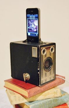 iPhone Charger iPod dock with Vintage Brownie camera     (from Etsy user CraftArkStudio)   http://www.etsy.com/listing/96228546/iphone-charger-ipod-dock-with-vintage?ref=sc_2=