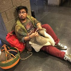 The natural habitat of a college student who knits. On the floor and knitting. #menwhoknit #guyswhoknit #knittingbasket #naturaliayarn #penguono #westknits #knitting #yarnporn #yarn