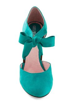 Make today count by treating yourself to an afternoon adventure in these d'Orsay wedges from Chelsea Crew! Crafted from vegan faux suede in an invigorating teal hue, these bow-tied shoes are a delightful complement to your carefree smile and floral frock. Leave your worries behind, slip into this mid-height pair, and embark on an effervescent excursion with your dearest friends!
