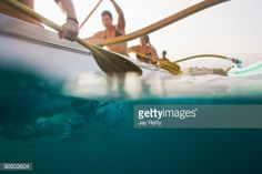 Stock Photo : Young female members of a competitive canoe team in Hawaii practice for the upcoming state competiti