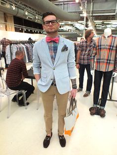 """Nerd cool on show.  Love the mash up of styles and colors.  And the surprise of the tattoo sleeve on his arm.  He's clearly is in the know when it comes to style.  I just like that he kept his dork dapperness """"real."""""""