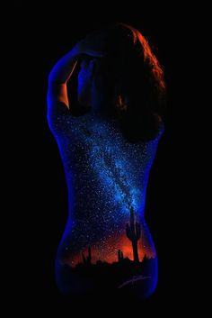 This is a collection of Black Light Bodyscapes by artist and photographer John Poppleton. John paints these landscapes onto female models and lights them w