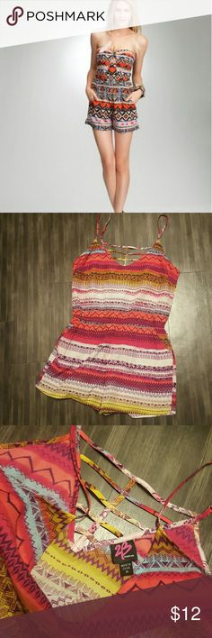 """Bebe Aztec Neon Romper Like new Romper from 2B by Bebe. In like new condition. Stock photo is a similar Style by baby but not identical. Has pockets, adjustable straps, and elastic waistband to fit different shapes. Machine washable and absolutely adorable with a hint of sexiness. Measurements lying flat: chest 18.5"""" waist 14-17"""", total length varies on strap adjustment.  Waislinr to short hem is 12.5"""". 2.5"""" inseam. Over 400 listings you can bundle in my closet! bebe Pants Jumpsuits…"""