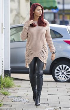 Sizzling style: Amy Childs decided to keep her famous assets under wraps as she headed out in Essex on Saturday, rocking a casual yet glamorous ensemble
