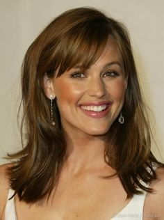 medium hair with side bangs. love this haircut and style!
