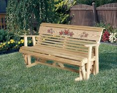 LuxCraft Rollback Rose Garden Glider from DutchCrafters Amish Furniture. Made from pressure treated, kiln dried pine wood, this outdoor glider bench features a lovely rose accent on a wide back panel. Bask in the beauty of your backyard while gliding your way to relaxation on this outdoor wooden seating. Available in 4' or 5'. Options to add pillows and personlized plaque. #outdoorgliderbench #wooden #cushions #gliderbench