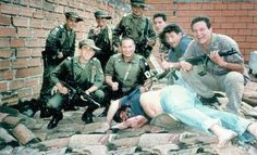"""The bloodied body of Pablo Escobar lies on a Medellin rooftop where he was shot dead by members of the Colombian National Police """"Search Bloc"""" who stand triumphantly around their kill December 1993 Pablo Emilio Escobar, Pablo Escobar Body, Pablo Escobar Dead, Search Bloc, Narcos Escobar, Mafia, Indira Ghandi, Colombian Drug Lord, Manolo Escobar"""