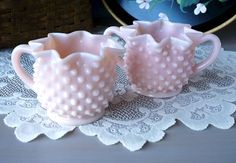Gorgeous Fenton pink milk glass hobnail cream and sugar set. The two-handled open sugar bowl and creamer are in wonderful condition, as if
