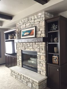 Wood burning fireplace unit with hearth and stone surround. Custom built in cabinets flanking fireplace. House, Fireplace Built Ins, Build A Fireplace, Living Room With Fireplace, Basement Fireplace, Basement Remodeling, New Homes, Built In Around Fireplace, Fireplace