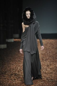 Givenchy  an aisle of leaves and bridsmaids in long layers