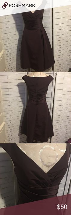Davids bridal dress N.044 Beautiful dress perfect for any semi formal occasion! Very flattering and classic silhouette! No notable flaws, hidden zipper in the back works perfectly. 100% polyester. David's Bridal Dresses