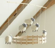 Sheep Mobile:  I see this being easily done (with a sheep pattern of course), and I don't know- wooden craft sticks?!.**found at potterbarnkids.com