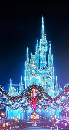 Christmas Disney Magic Kingdom Castle with the wreaths (photographer unknown) Have a wonderful Christmas - stay at www.orlandocondoatlegacydunes.com