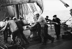 """""""Parma"""" - crew at the capstan, weighing anchor."""