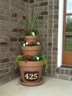 Flower tower for the front porch. Simply put upside down pots for the next one to sit on. Run a pole up thru the holes of each one to secure.