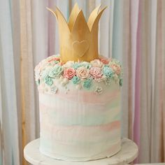 This stunning birthday cake is straight out of a fairy tale!  Topped with a gold crown and a field of pastel flowers, this Fairy Princess Birthday Cake cake will add a very happily ever after to any birthday celebration.