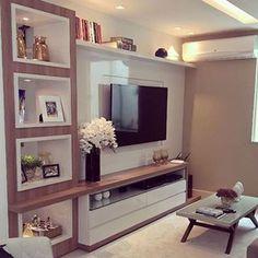 Belíssimo projeto para sala de estar. Os nichos laterais deixaram o painel ainda mais charmoso. #salameunovoapê   Projeto Realizze Ambientes Planejados