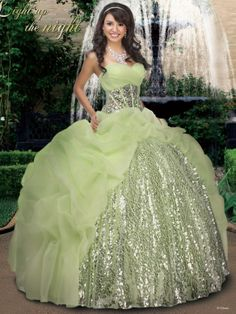 A stunner, this spectacular ball gown quinceanera dress is a dazzling number. This organza Tiana quinceanera dress by Impression 41008 displays a sweetheart neckline, ruched bust, and wide waist encrusted with jewels and sequins. A ball gown with ruffled skirt and sequins in the center completes this look. Lace up back. This quinceanera dress comes in these colors: sage/silver, melon/silver and silver/silver. Make a statement wearing this glamorous ball gown.