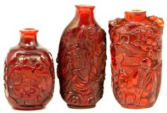 3 CHINESE HAND CARVED AMBER SNUFF BOTTLES - EliteAuction.com