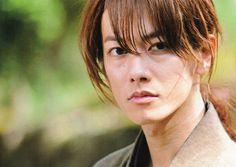 Red hair, cross-shaped scar... You must be Hitokiri Battousai.