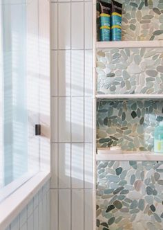 A small bathroom in a lakeside home received a spa inspired makeover thanks to @deliciouskitchens 🧖♀️ Featuring soothing coastal pebbles from #gardenstatetile, the once unused bathroom was transformed into a zen retreat. 📸: @kimgrahamphoto. Bathroom Design Inspiration, Pebble Mosaic, Small Bathroom, Zen, Coastal, Photo And Video, Inspired, Instagram, Home Decor