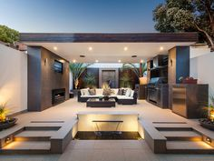 Modern outdoor kitchen doubling as a cozy lounge corner