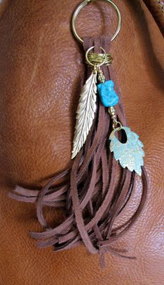 #ThePaintedCabeza ~ This handmade tassel charm can be used on your purse, backpack, zipper, wherever youd like to add some charm! Its made up of brown suede,
