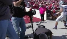 Video: Football Player Falls On and Snaps Canon Telephoto Lens in Half on the Sideline