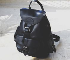 Black Backpack With Buckle...Beautiful and least expensive leather backpack that I've found...