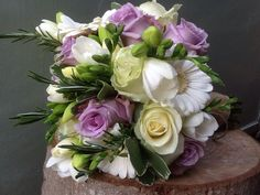 Bridal bouquet including germini, roses, freesia and Rosemary