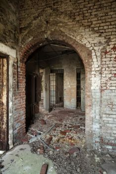 Old arched entrance to reformatory; Hart Island, NYC. Although all the buildings have been abandoned, there is a cemetery there that is still in use. Almost a million bodies are buried there, many in mass graves. It's where all indigent people are buried in NYC. The island still takes in about 1500 bodies per year. It's a constant struggle to find space and they have to constantly reuse trenches.