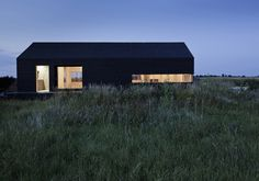 green design, eco design, sustainable design, Adaptive reuse, Carl Turner Architects, Ochre Barn, Stealth Barn, Converted Ban, glass doors, Norfolk, England, Oriented Strand Board