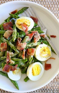 Simple salad of asparagus, hard boiled egg and bacon tossed with a Dijon vinaigrette.