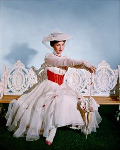 Julie Andrews (Mary Poppins)--I've always wanted that dress, the boots, the hat, the parasol--and what the heck, throw in the bench too!