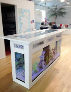 An AquariumGroup custom built freestanding island bar aquarium designed as a meeting point to sit, drink and relax