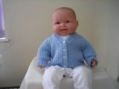 CARDIGAN, I think that babies always look cute and cuddly in a hand-knitted cardigan or jumper.