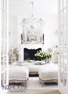 Your current bedroom would become a walk-in closet/seating area that leads into the bathroom. Build a fireplace (gas to avoid mess) and arrange a beautiful chair or ottoman set in it like this one, although the walls would not be white. Drop another chandelier into the room.
