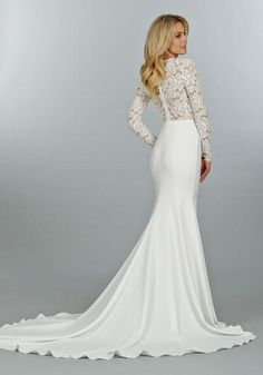 Tara Keely Style 2450 Venise lace and crepe sheath bridal gown, long sleeve bodice with cashmere lining and deep V plunge neckline, slim skirt with chapel train.