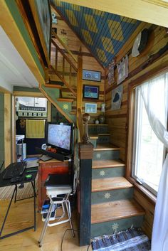 Great stairway to a loft bedroom! This tiny storybook cottage was handcrafted by its owner. It has 1 bedroom in 520 sq ft.   www.facebook.com/SmallHouseBliss