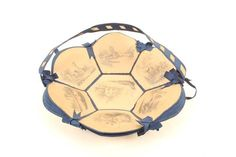Lot 184 - A rare card and blue ribbon sewing basket, circa 1850, formed from seven pencil drawn landscape
