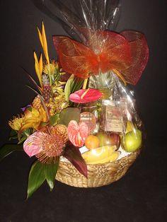 """Tropical Splendor"" an Authentic Hawaiian gift basket with a gorgeous fresh tropical arrangement, fresh seasonal fruit (pineapple, papaya, mango, apple-banana, and more), and premium made in Hawaii snacks.  Price: $180.00"