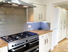 A Range Cooker with Sage Green Metro Tiles