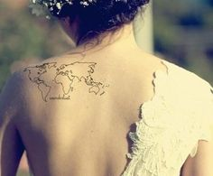 World map tattoo in the back on wedding day.
