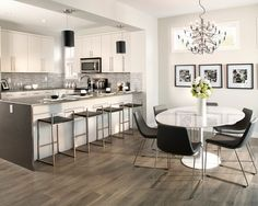 Light Grey Laminate Flooring Ideas for Kitchen With Modern White Furniture and Crystal Chandeliers Suit in Laminate Wood Flooring in Kitchen - Pulmedia.com