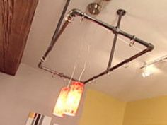 Hanging Pot Rack on DIY network.Takes two hours, easy, in the $0-50 price range.