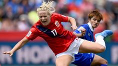 OTTAWA, ON - JUNE 07: Lene Mykjaland of Norway is challenged by Warunee Phetwiset of Thailand during the FIFA Women's World Cup 2015 Group B match between Norway and Thailand at Lansdowne Stadium on June 7, 2015 in Ottawa, Canada. (Photo by Lars Baron - FIFA/FIFA via Getty Images)