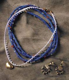 rolotê e pedras / coração . Azul e branco ouro e pedras brasileiras de junia machado