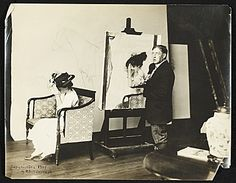 Edmund C. Tarbell at work on Girl Putting on Her Hat , 1907