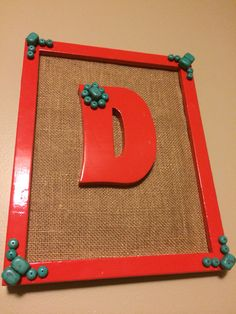 I made this for my mom for Christmas. It's a plastic frame, spray-painted, spray-painted wooden D, burlap background that I glued to the backboard of the frame, and used stones from a necklace from Premier Designs. Love it!!
